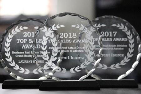 Grand Realty of America awards Business Broker Laurent Isorez